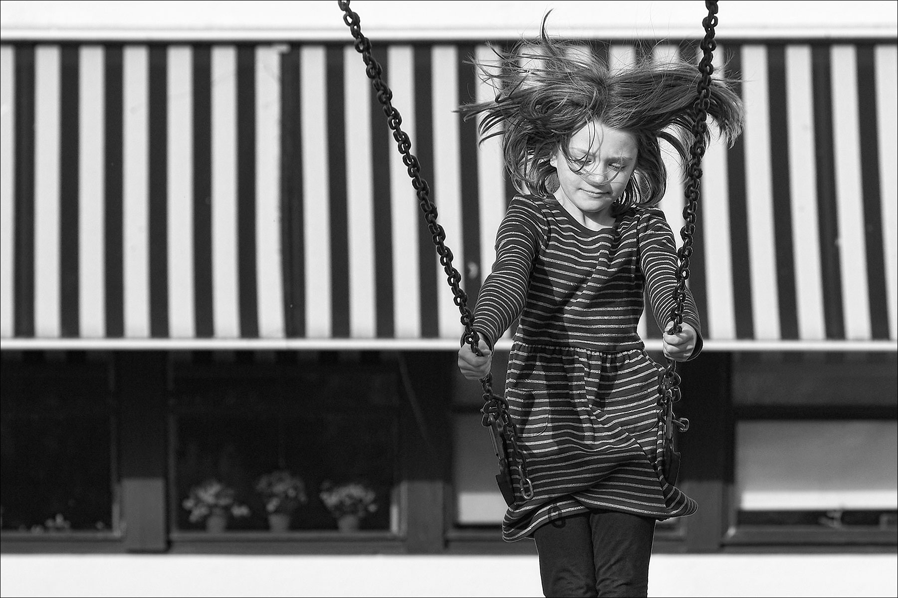 On a swing at Salt Spring Elementary ©johncameron.ca